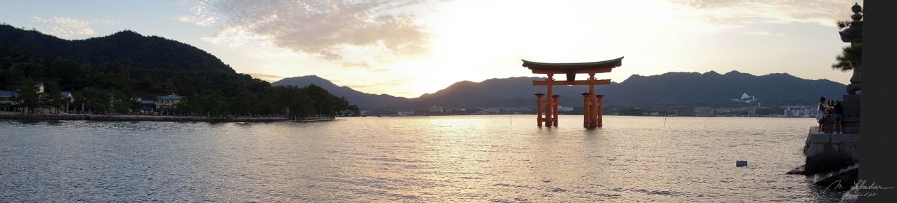 sunset over Torii gate Itsukushima shrine Miyajima island Japan
