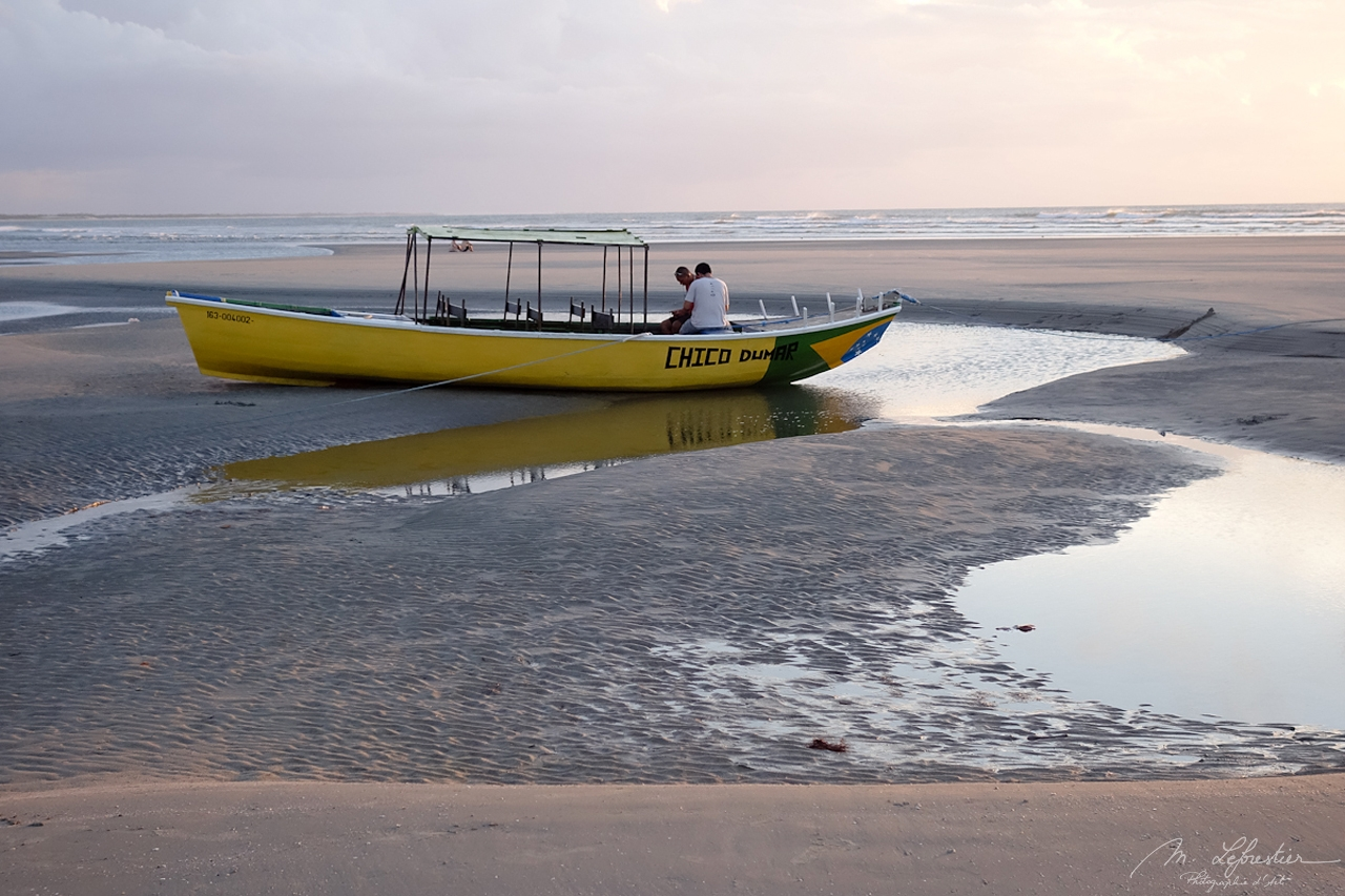 parked boat during sunset at Jericoacoara Beach, Brazil