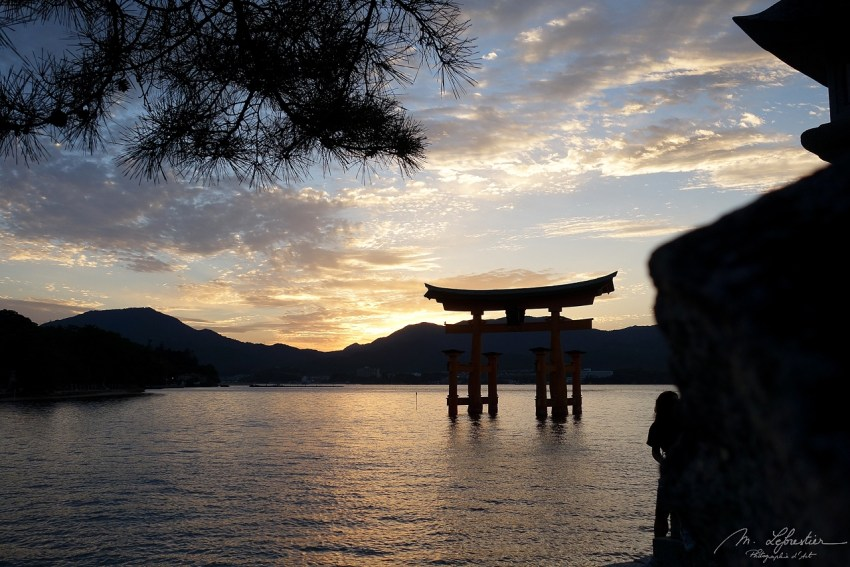Itsukushima shrine and Torii gate at Miyajima island Japan at sunset