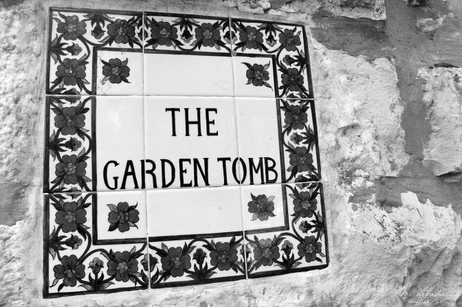 sign at the entrance of the garden tomb of jesus in Jerusalem, photo in black and white
