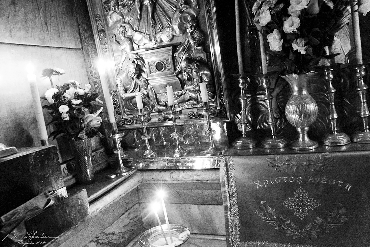 inside the tomb of Jesus in the Holy Sepulchre church in Jerusalem