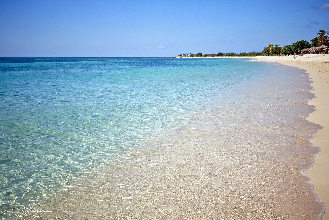 view of the playa Ancon beach by Trinidad in Cuba, with pristine water and white sand Beach