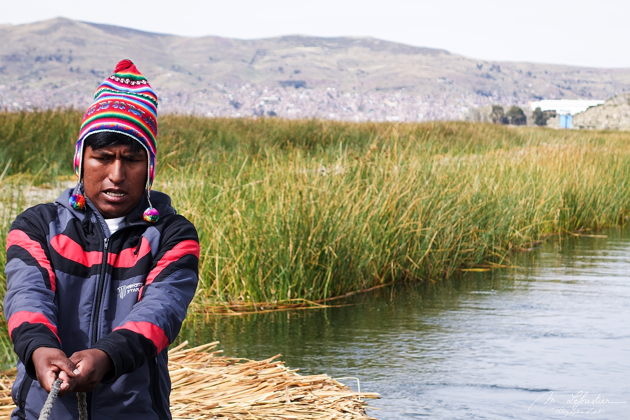 peruvian man sailing on the lake Titicaca in Peru