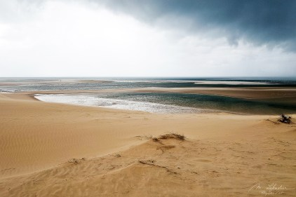 beach on the Bazaruto island by the sand dunes during a storm in Mozambique
