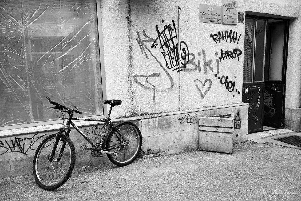 black and white picture of a bike in the street of Tuzla in Bosnia Herzegovina