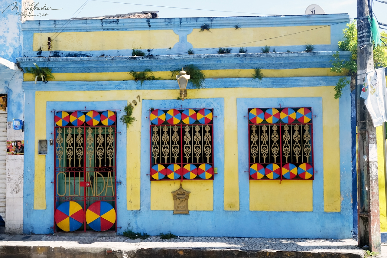 facade of a blue and yellow house in the colonial city of Olinda Brazil