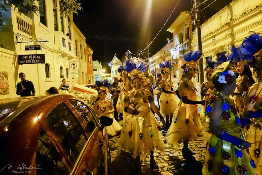 women dressed up and dancing to music after carnival in Olinda Brazil during the night