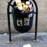 a full litter bin in a street in Santiago Chile