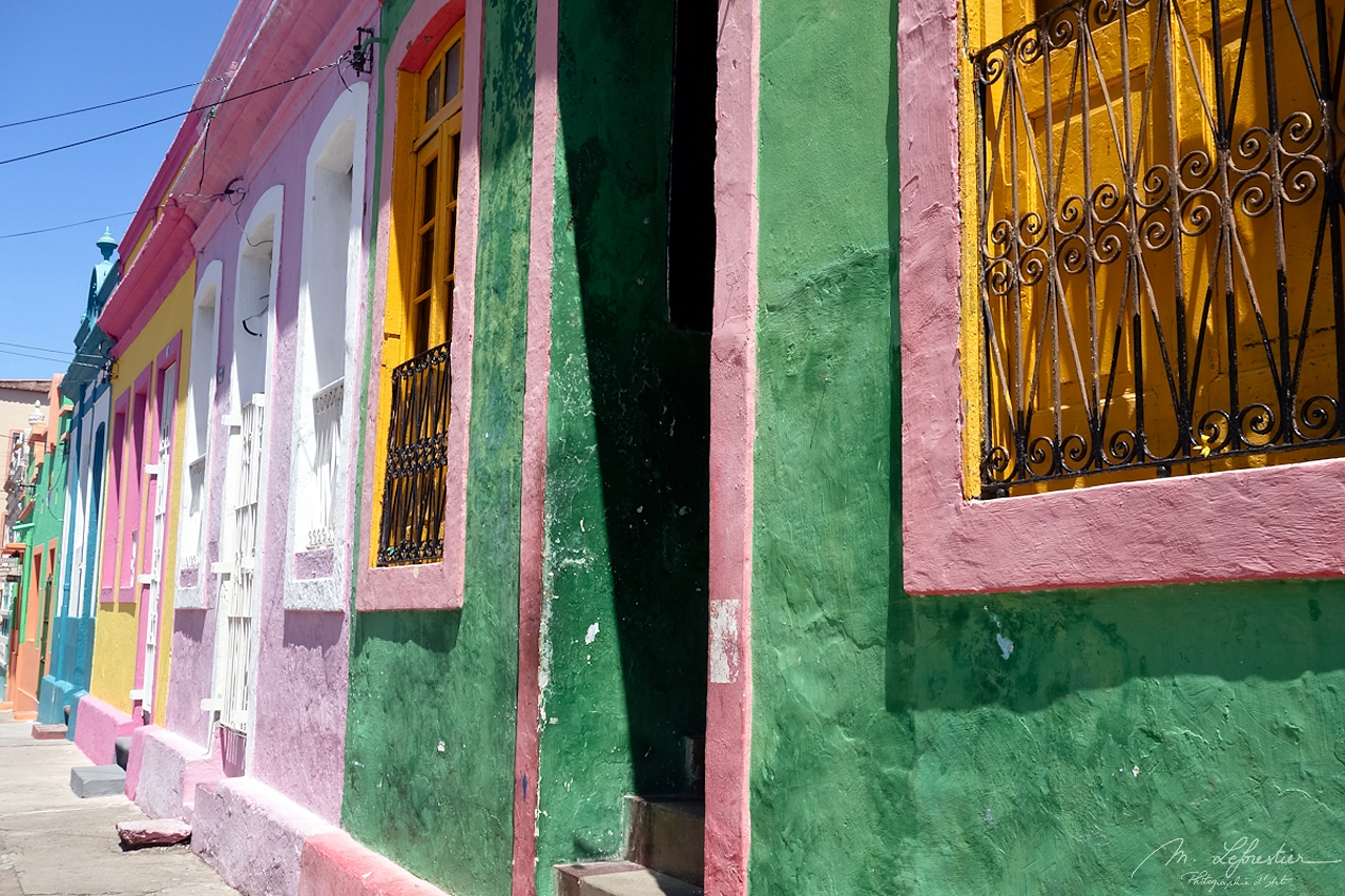 colorful houses painted in green, bink , yellow and orange in Olinda Brazil