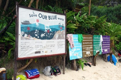 save our blue world sign in Maya Bay in Krabi Thailand before the closure of the beach