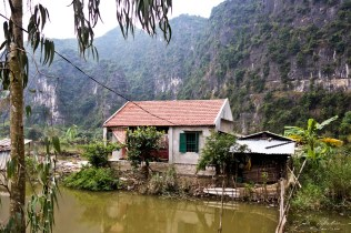 local house in Tam Coc rice fields seen from the biking route in Vietnam