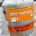 an orange litter bin in Vienna Austria Ihre papiere bitte, du hast es in der hand. bau keinen mist