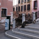 a litter bin at the bottom of stairs in Venice Italy