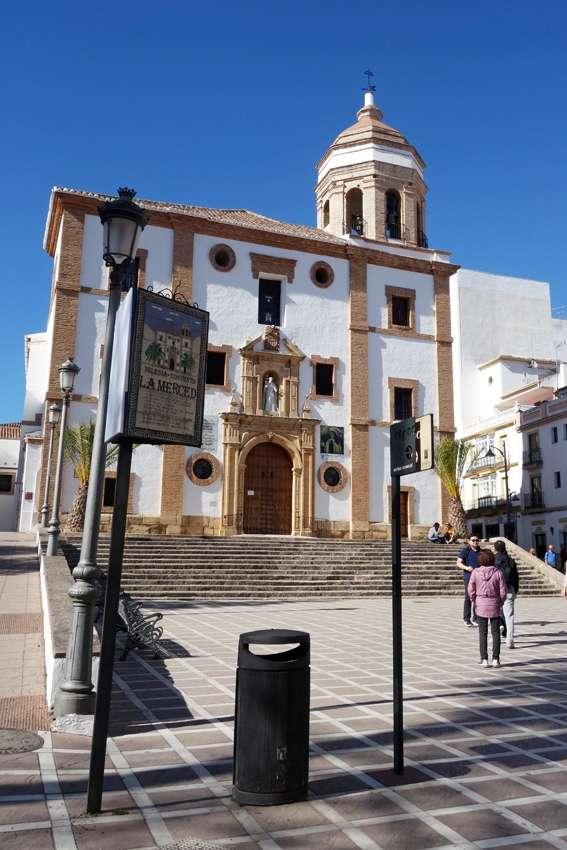 a litter bin in front of the church convent La Merced in Ronda Spain