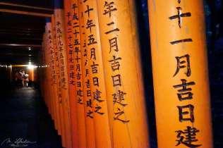 japanese inscriptions on the Torii gates of the Fushimi Inari Shrine in Southern Kyoto