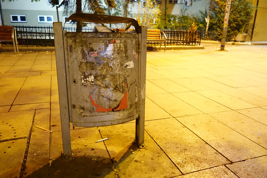 a litter bin by night in the main street of Pristina in Kosovo, Nena Tereze
