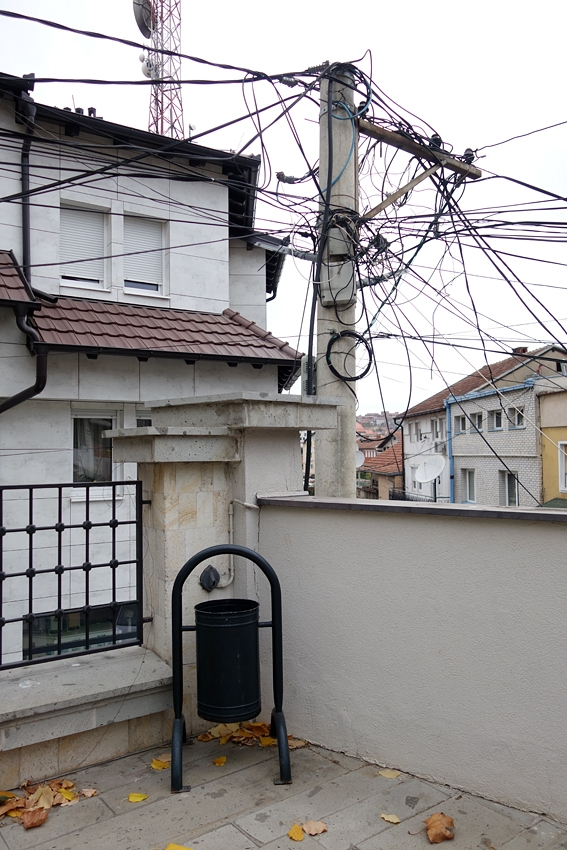 a litter bin in the back of the grand mosque by electric wires in Pristina Kosovo