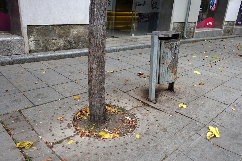 a litter bin by a bench in Pristina Kosovo