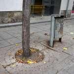a litter bin by a bench in Pristina Kosovo