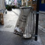 a litter bin with a transparant plastic bag in Paris France