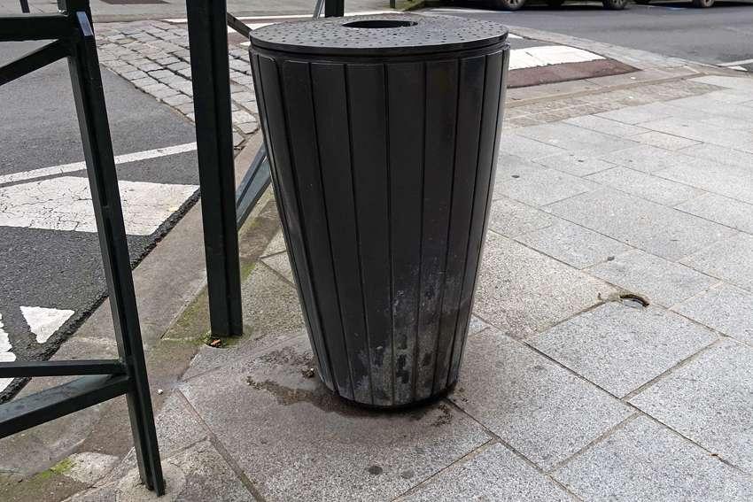 a litter bin on the side walk in Provins France