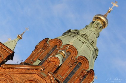 eastern orthodox Uspenski cathedral in Helsinki on a winter day with a clear blue sky