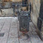 an old litter bin at the side of Charles bridge in Prague Praha in the Czech Republic