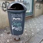 a grey litter bin in a street of Porto in Portugal