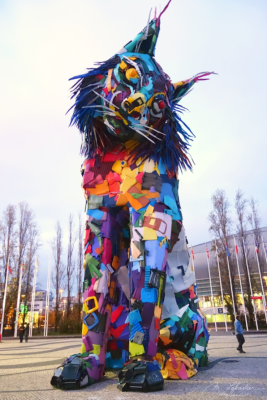 front picture of the sculpture made of recycled material by Artur Bordalo representing an iberian lynx in the Nations Park in Lisbon , Portugal