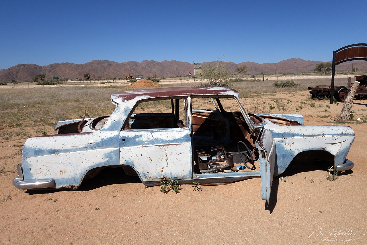 a blue abandoned car in the Namib Desert at the Solitaire gas station and Bakery