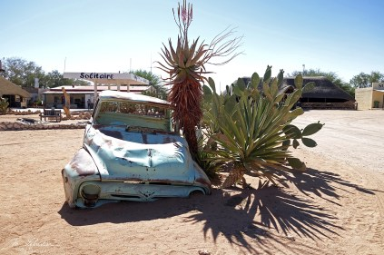 an old rusted car at the Solitaire gas station in the Namib desert in Namibia