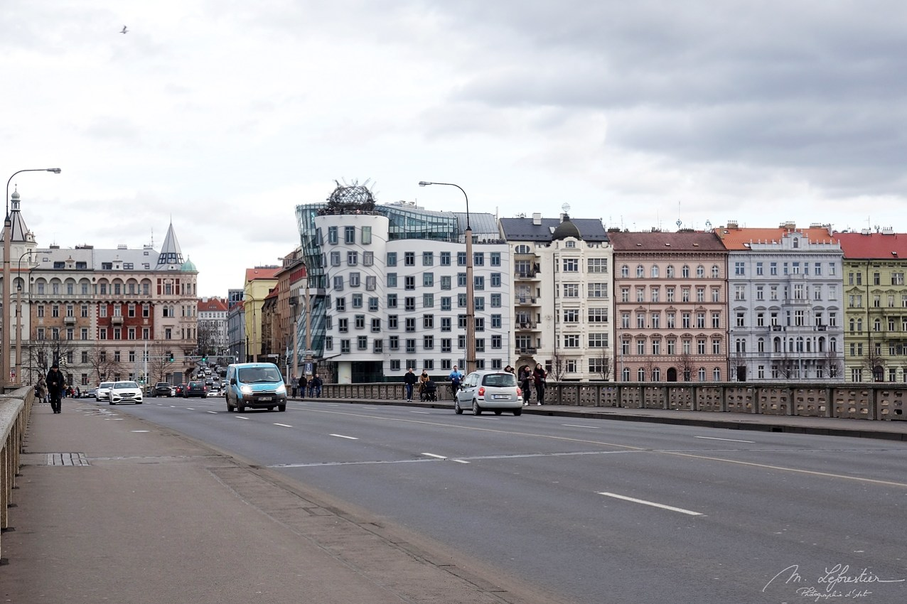 the dancing house on the riverfront as seen from the Jirásk?v most bridge in Prague