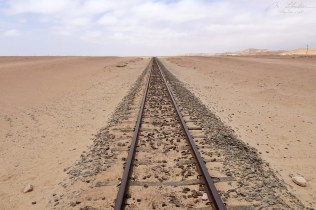 a railroad in the middle of the Namib desert