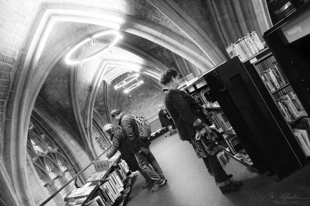 people are looking at books at this bookstore inside the Dominanen church in Maastricht, the Netherlands