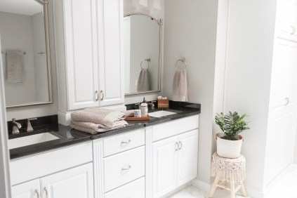 Home design choice Classy Black counters and white cabinets in the modern farmhouse bathroom