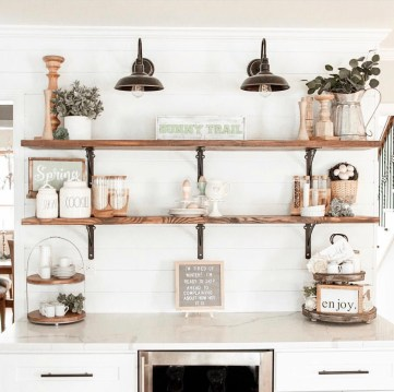Home designed with Open shelving and shiplap and black barn lights