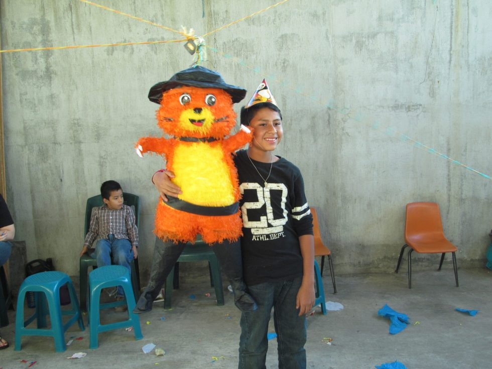 Luis posing with his piñata for his 14th birthday party.