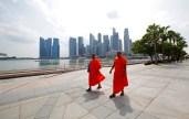 Singapore - Orange bonzes walking down concrete