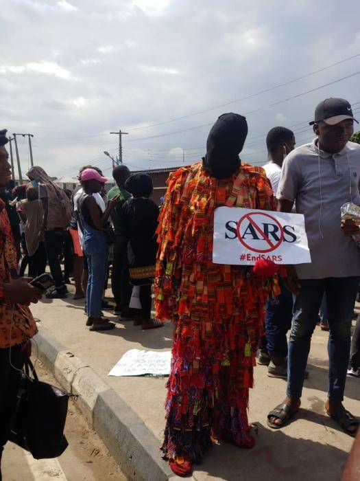 Masquerade Pictured at the #ENDSARS Protest in UNILAG School Gate (Photos)