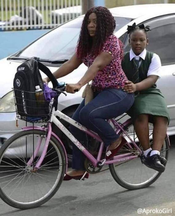 Okada Ban: Woman Takes Her Daughter To School By Bicycle