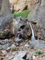 Silly people climbing a waterfall