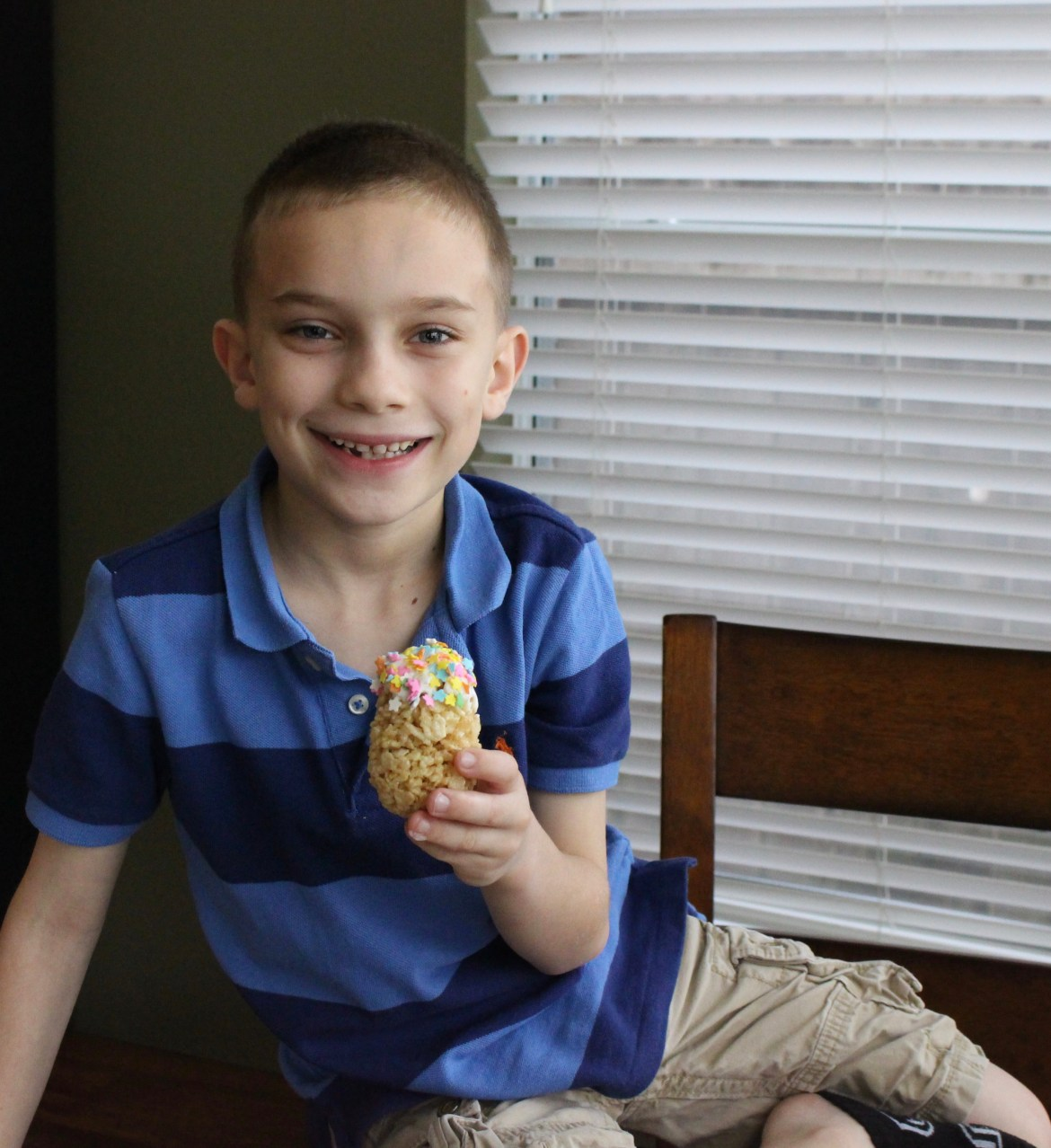 Parker showing his decorated Dipped Easter Egg