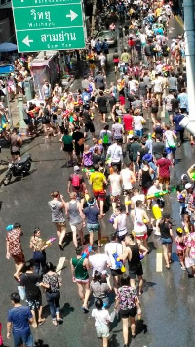 People walking on silom road Songkran