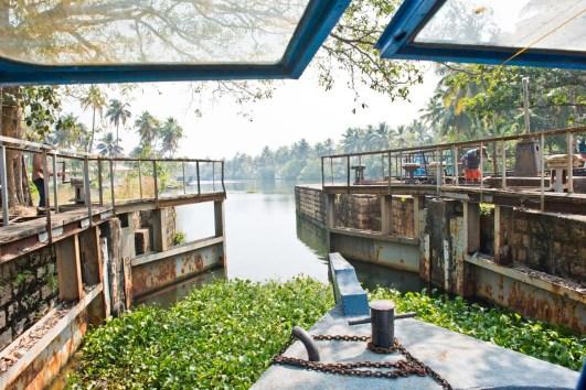 Man operating Watergates in Kerala Backwaters