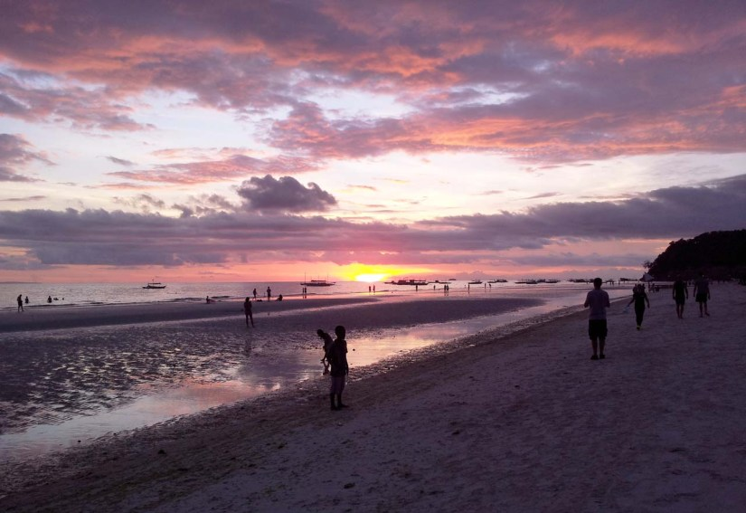 Sunset stroll on White Beach Boracay in Philippines
