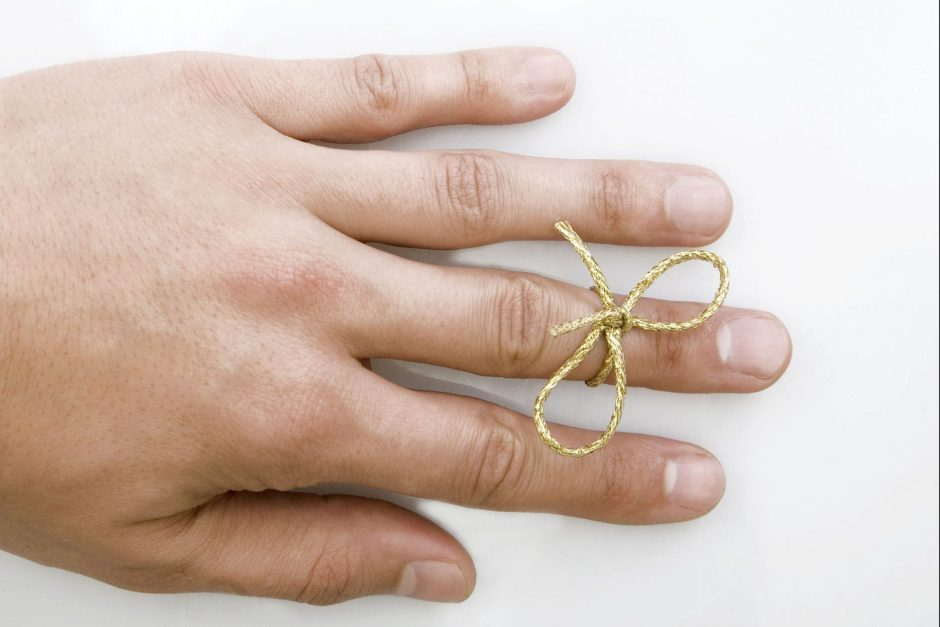 hand-with-bow-tied-around-finger-to-remember