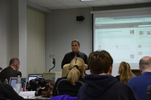 Instructor Martin Brossman listening to a student's question during class.