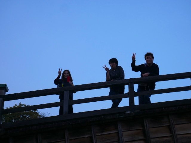 photo of three people with the v sign