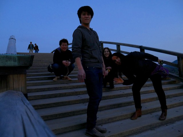 photo of four people on kintai bridge