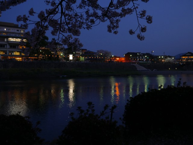 photo of an evening reflection of lights on the nishiki river